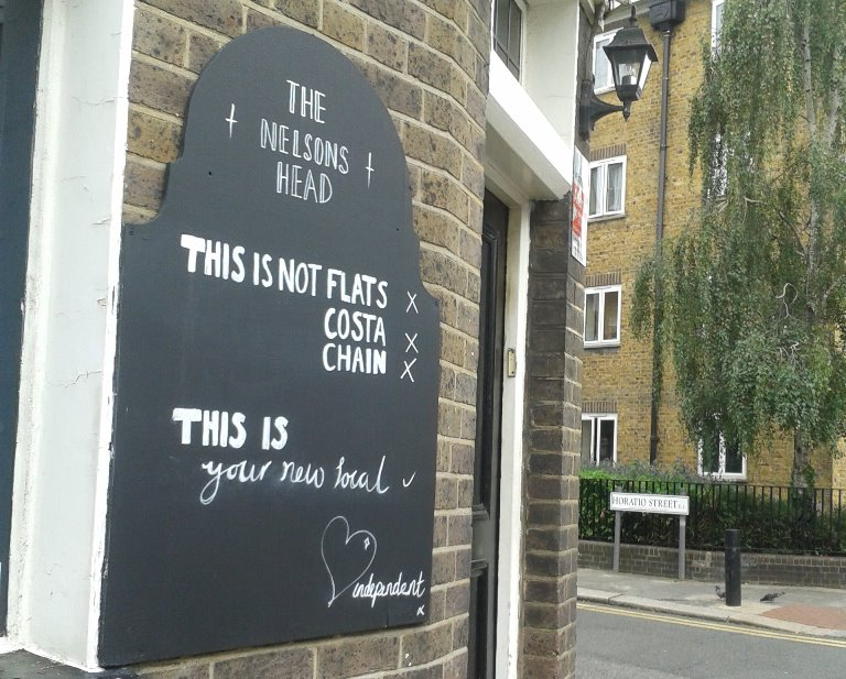 Sign advertising newly relaunched pub